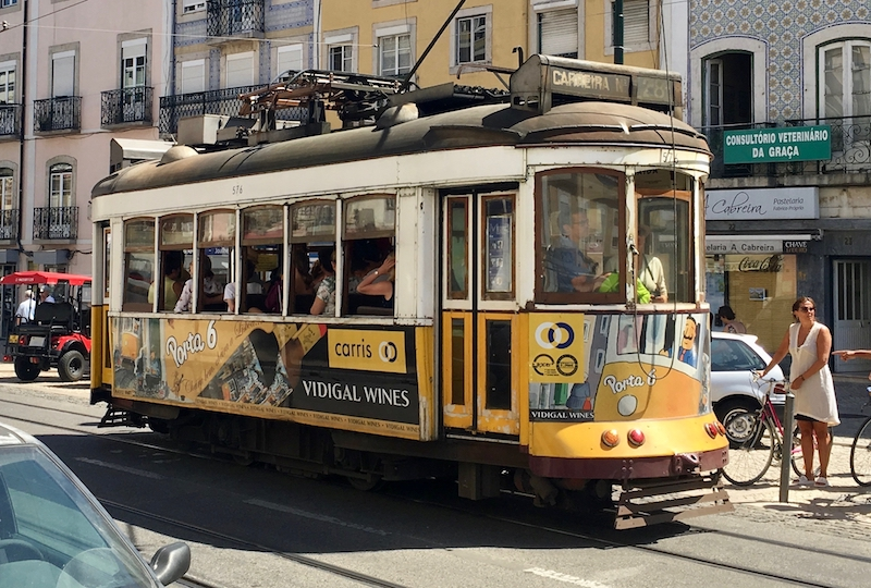 The traditional tram 28 with the advertising of wine port 6 of Vidigal Wines